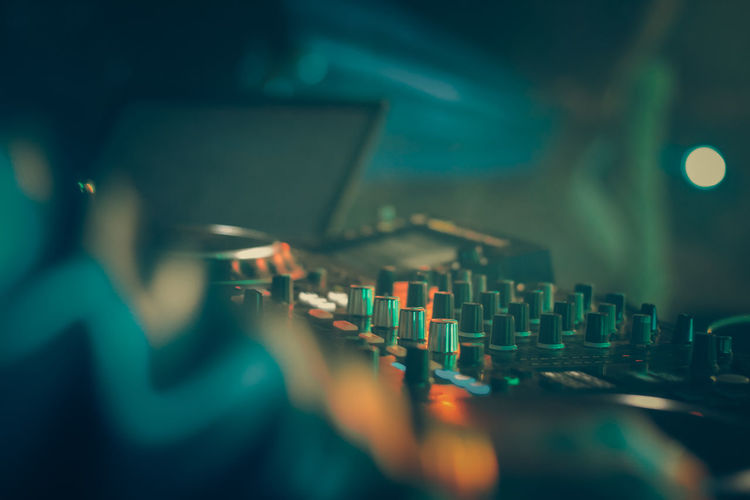 Close-Up Of Sound Mixer At Nightclub