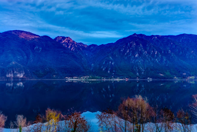 Blue hour at Lago D´Idro Hour Alps Beauty In Nature Blue Clouds Cold Idro Italian Lake Lake View Mountain Mountain Range Nature No People Outdoors Peaks Reflection Scenics Shore Tranquil Scene Tranquility Water