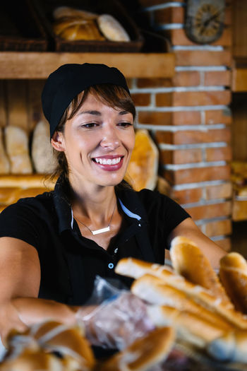 Young Woman Working At Bakery