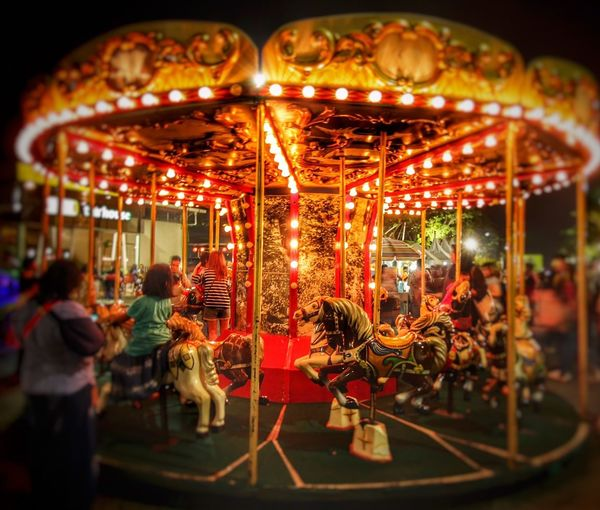 My head's a carousel of pictures and the spinning never stops.. Carousel Amusement Park Bright Spinning Wheel Photography
