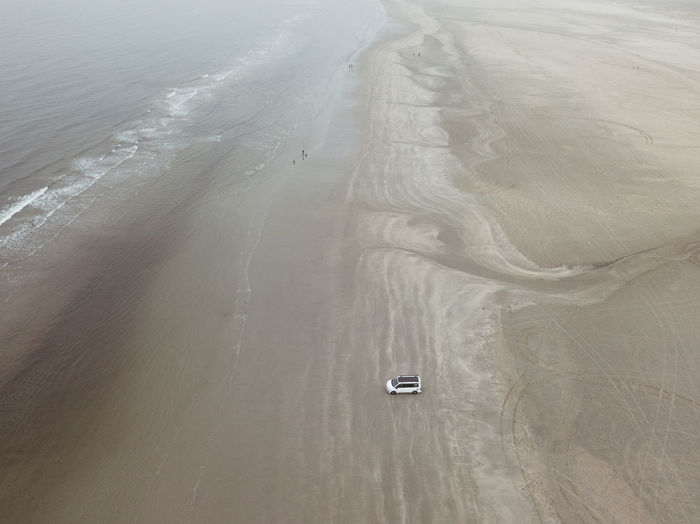 Aerial View Beach Beauty In Nature Day Environment High Angle View Land Mode Of Transportation Motion Nature No People Outdoors Road Scenics - Nature Sea Tranquility Transportation Travel Water