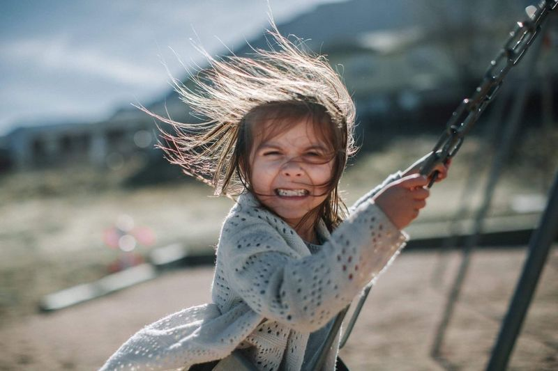 Swinging! Childhood Focus On Foreground Children Only Child One Person Outdoors One Girl Only Happiness Portrait Smiling Day Playing People Close-up Sky