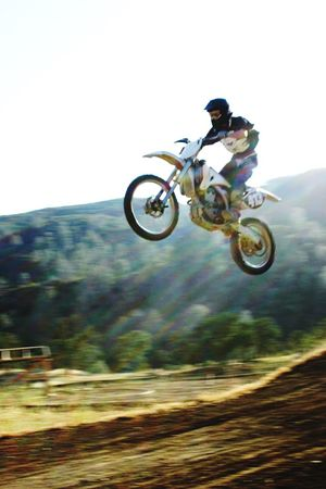 Yz250 Jumping Mid-air Motion Extreme Sports Exhilaration Speed Freedom Ride In Paradise Dirtbike Little Nick Motocross Do What You Love Jump Motorcycle Flying High Mountain Sun Rays Rest In Peace ❤ Capturing Movement Capturing Motion