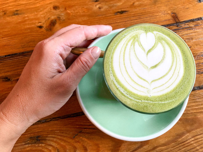 Matcha latte Matcha Matcha Lattee Latte Green Tea Latte Healthy Drinks Food And Drink Drink Cup Coffee Refreshment Mug Human Hand Human Body Part Coffee Cup Hand Frothy Drink Froth Art Hot Drink One Person Cappuccino Holding Indoors  Table Saucer Finger Crockery
