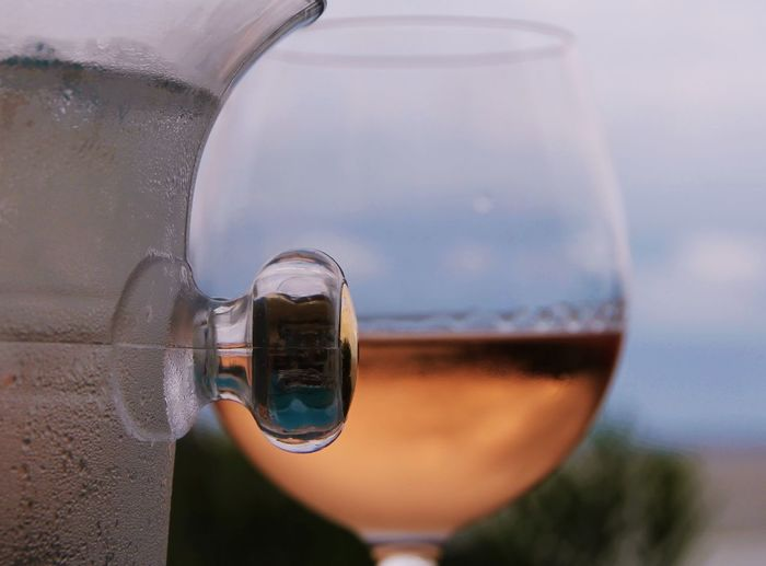 Cropped Image Of Pitcher Against Wineglass