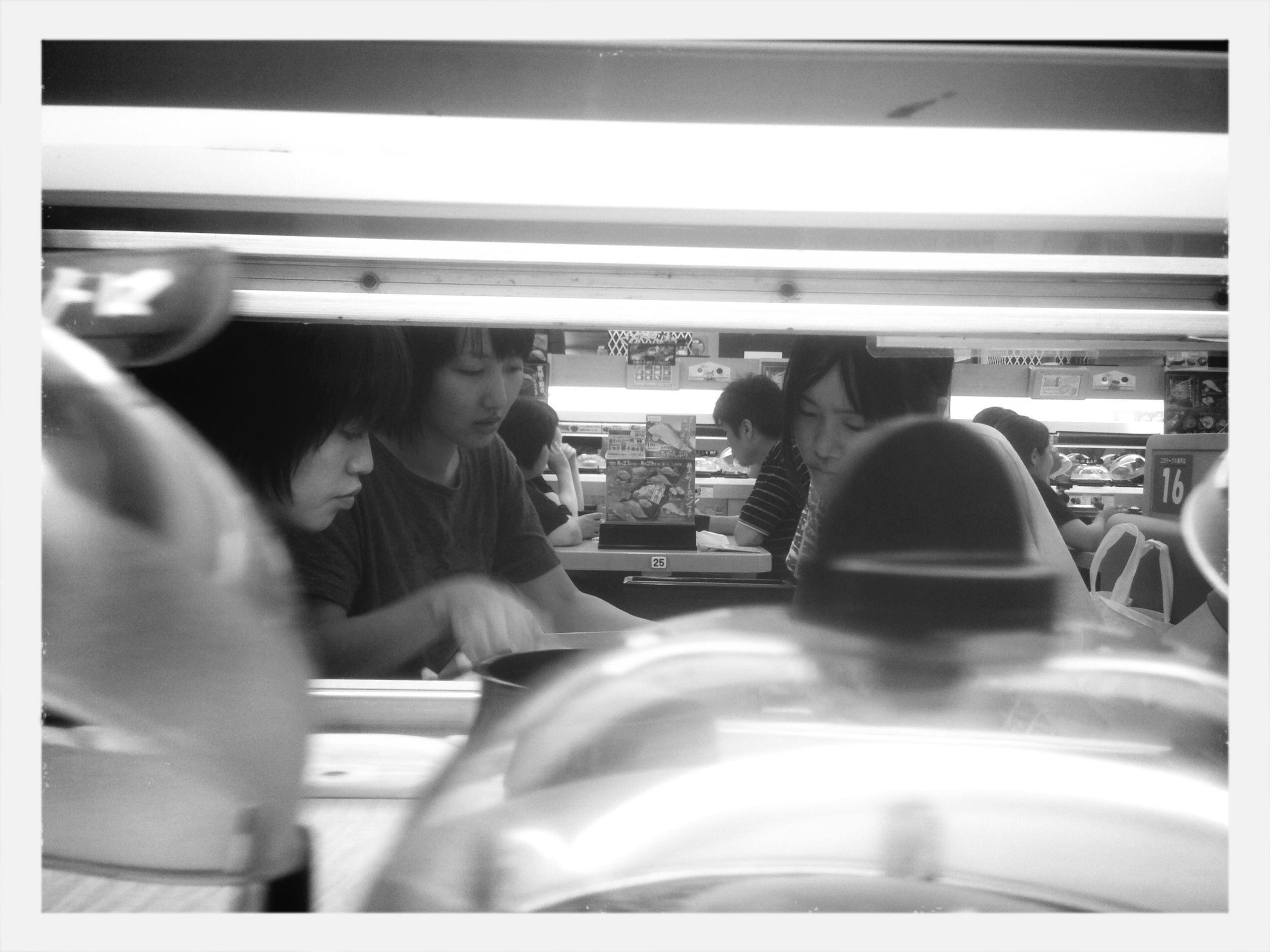 indoors, lifestyles, vehicle interior, men, transportation, leisure activity, transfer print, person, sitting, mode of transport, public transportation, travel, passenger, land vehicle, window, vehicle seat, bus
