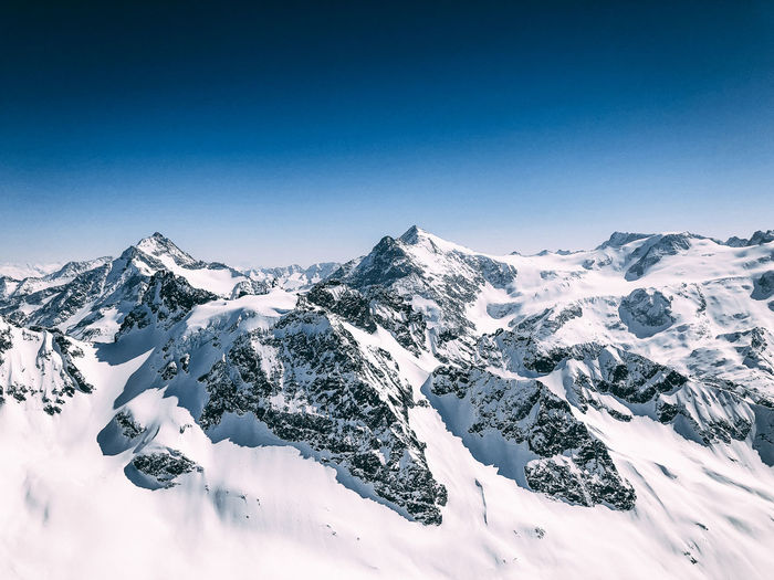 on the top of the world Snow ❄ Alps Beauty In Nature Blue Clear Sky Cold Temperature Copy Space Day Environment Landscape Mountain Mountain Peak Mountain Range Mountains Nature No People Scenics - Nature Sky Snow Snowcapped Mountain Switzerland Tranquil Scene Tranquility White Color Winter