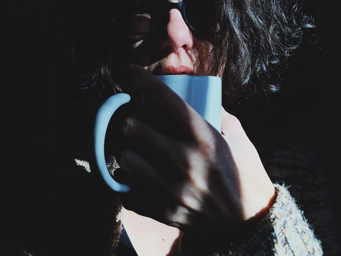 Cup of coffee One Person Real People Human Body Part Sunlight Indoors  Lifestyles Women Young Adult Human Hand Hand Wireless Technology Adult Leisure Activity Close-up Communication Nature Nail Body Part Day Human Face