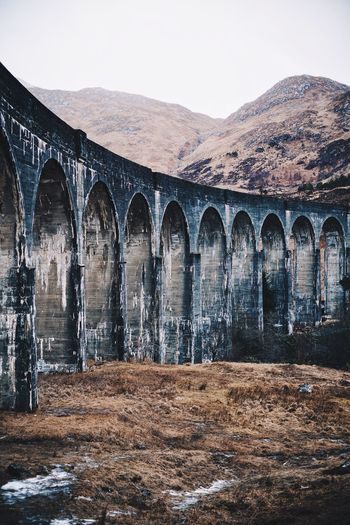 In dreams, we enter a world that's entirely our own. Landscape Outdoors Nature Photography Viaduct Bridge - Man Made Structure Scotland Glennfinnan Britain Arch Built Structure Architecture Day No People Outdoors Water Sky Mountain Close-up