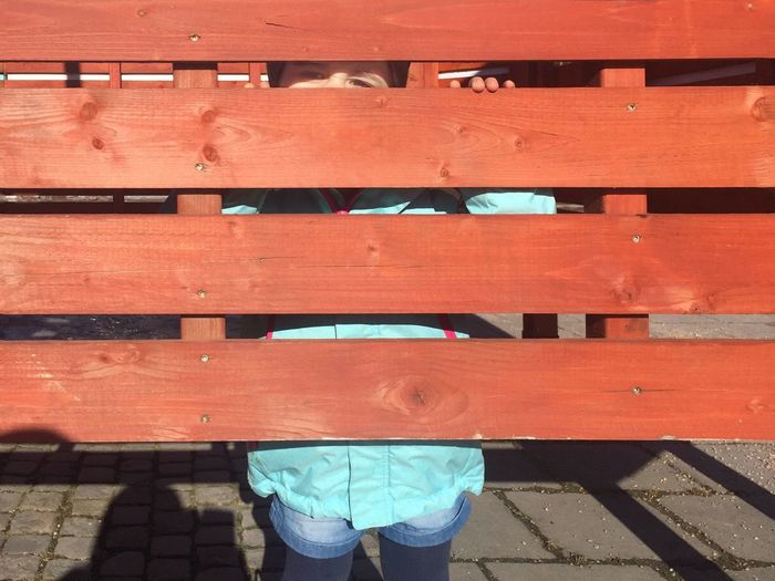 Childhood behind the fence ... Secret Girl Child Sneak Playing Playground Eyes Day Low Section Standing Red High Angle View Outdoors One Person