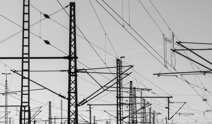 Black And White Black & White Blackandwhite Industrial Business Energy Power Line  Power Low Angle View Sky Cable Electricity  Connection Fuel And Power Generation Power Line  Power Supply Technology No People Electricity Pylon Nature Complexity Day Outdoors Metal Architecture Industry Built Structure Construction Industry Electrical Equipment