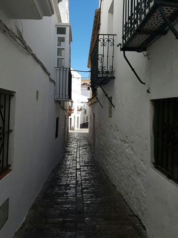Architecture The Way Forward Narrow Street Clear Sky Day Outdoors No People Cobble Stone City Life Narrowstreet Tarifa Tarifa Spain Old Town Historic Andalusia Sun Narrow Empty Sunlight Built Structure