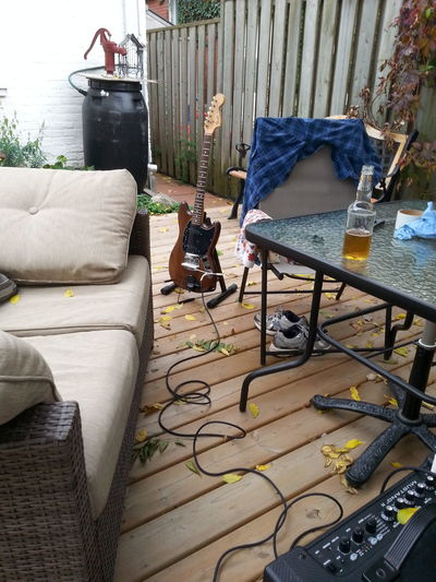 Table No People Horizontal Day Outdoors Guitar And Amp Warm Fall Day Enjoying The Outdoors Backyard Deck
