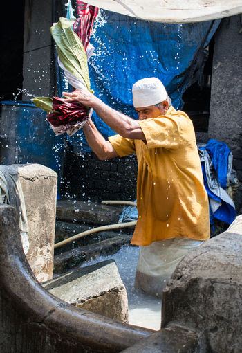 Mumbai's human washing machines, the people of the Mahalaxmi Dhobi Ghat : I saw a man where there was a basin full of soapy water where he stand inside, rinse and smash the clothes on those gritty rocks and used to spend most of his day knee deep in the soapy water. Clothes Dhobi Dhobighat Dhobikhana Mumbai Washing Washingmachine First Eyeem Photo