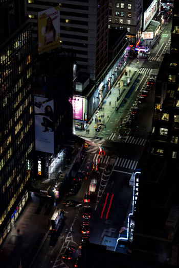 City Architecture Building Exterior Transportation Illuminated Built Structure Street Mode Of Transportation Motor Vehicle Night Road Sign Car Land Vehicle Traffic City Life City Street Building Communication Outdoors Office Building Exterior Skyscraper High Angle View New York Light Trail
