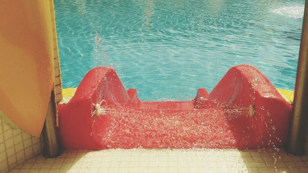EyeEm Selects Red Outdoors Day Water Swimming Pool Close-up Slide - Play Equipment Swimming Pool Slide Pool Slide Water Drops On Swimming Pool Slide Sommergefühle 100 Days Of Summer