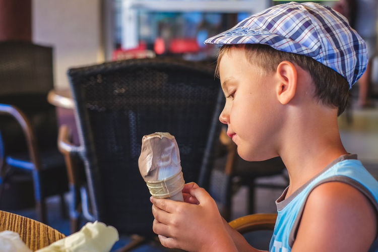 Side View Of Boy Holding Ice Cream