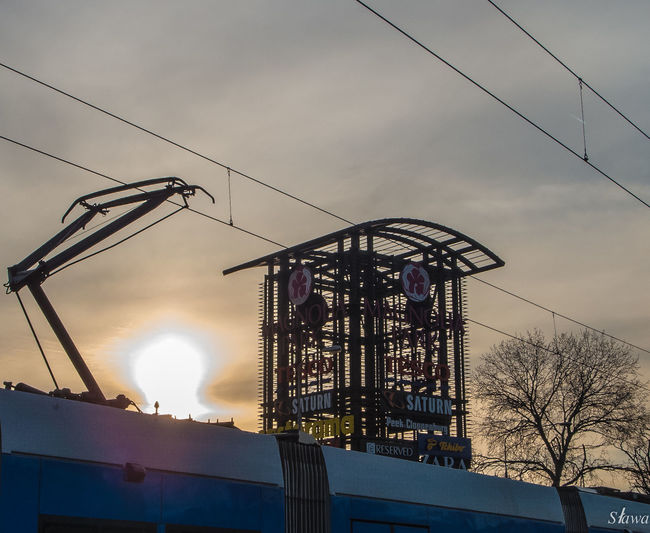 Colour Your Horizn Tram Tree Architecture Electricity Pylon Outdoors Sky Sun Wires Wires And Sky