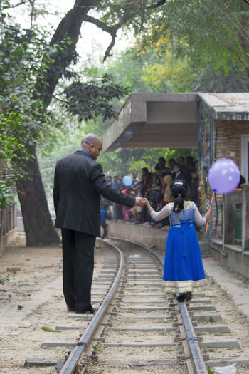 Fatherhood Moments Real Men Adult Day Father And Daughter Father Daughter Love Father Daughter Moments Father Daughter Walking Fatherhood  Full Length Men Outdoors People Real People Standing Togetherness Two People Walking On Railroad Track