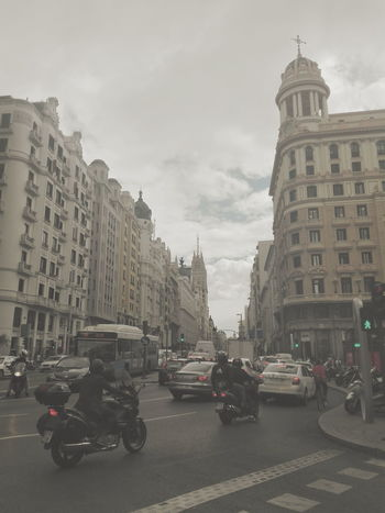 Gran Vía, Madrid. Architecture City Life Public Transportation Indoors  Mode Of Transport Building Exterior Transportation Built Structure Land Vehicle Architecture Car City Street Travel Travel Destinations Sky On The Move City Life City Street Tower Outdoors Person Houses Of Parliament Cloud - Sky
