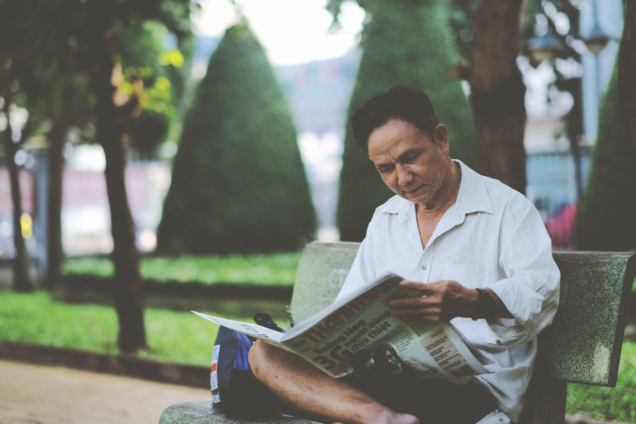 Early morning in Vietnam. Let enjoy simple life. Alone Early Morning Enjoying Life Front View Holding In The Park Newspaper Portrait Reading & Relaxing Reading Newspaper Readingtime Real People Side View Simple Moment Thanh Nien Newspaper Vietnam Vietnamese