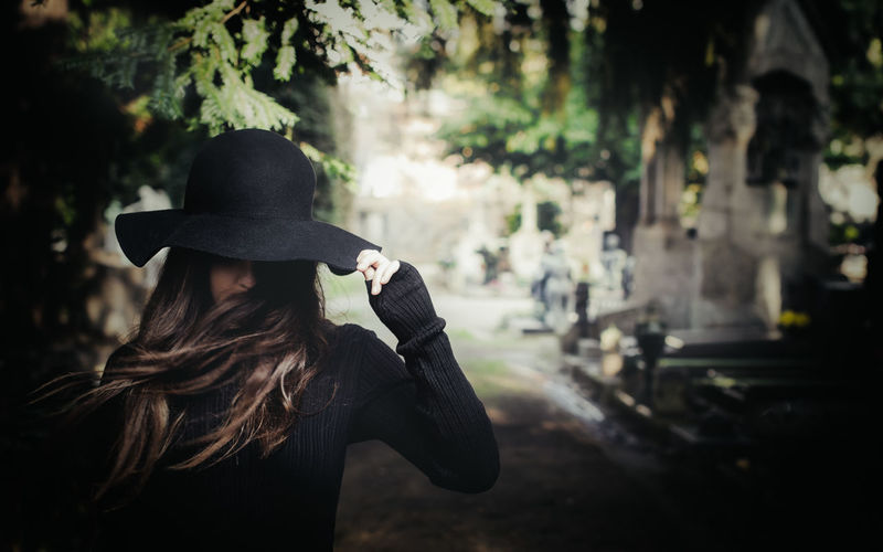 Adult Adults Only Beautiful Woman Beauty Brown Hair Cemetery Cimitero Monumentale Day Focus On Foreground Hat Incognito Milan One Person One Woman Only One Young Woman Only Only Women Outdoors People Real People Unrecognizable Person Women Young Adult Young Women