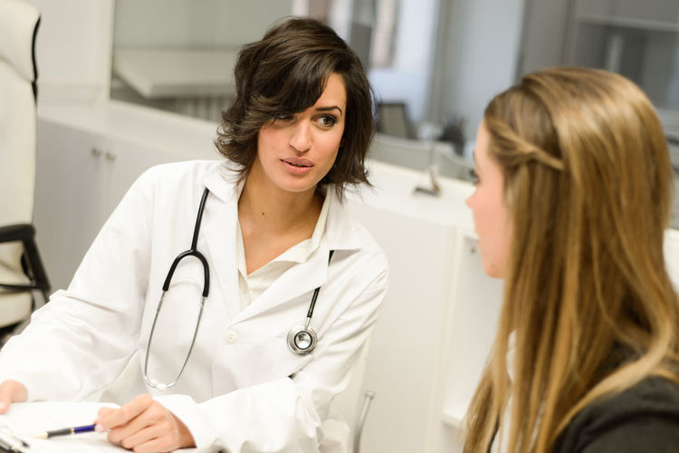 Female doctor discussing with patient at hospital