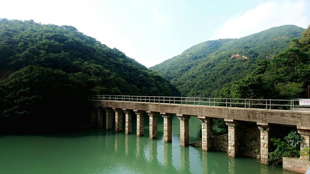Mountain Tree Bridge - Man Made Structure Nature Sky Tranquility Tranquil Scene Outdoors Scenics No People Beauty In Nature Water Day Lush - Description Tai Tam Reservoir Hong Kong Environmental Conservation Tranquility Tai Tam Country Park Nature Of Beauty Harmony With Nature Landscape Future Lake Harmony Of The Seas