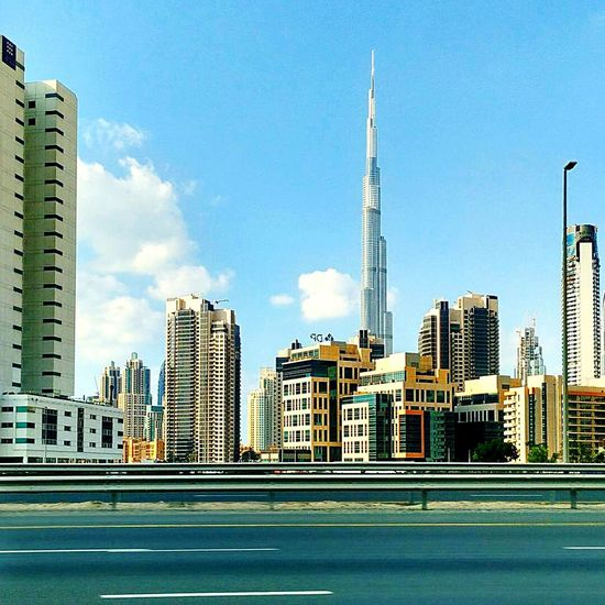 City Skyscraper Architecture Urban Skyline Cityscape Downtown District Modern Financial District  Building Exterior Tower Development City Life No People Outdoors Travel Destinations Business Finance And Industry Day Urban Road Sky Dubai Burjkhalifa