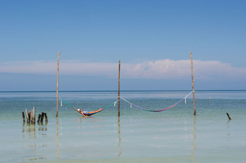 Chilling out in the Caribbean Holiday Island Life Mexico Relaxing Vacations Beachbum Beauty In Nature Carefree Caribbean Chill Hammock Holbox Horizon Over Water Island Nature Outdoors Paradise Sea Sky Solo Tranquility Travel Destinations Tropical Water Waterfront