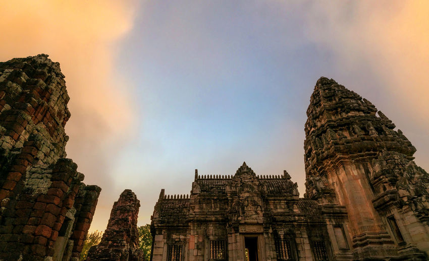 Low angle view of temple building against sky during sunset