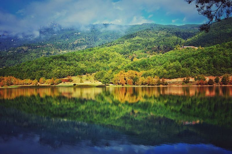 Scenic view of mountain reflecting on lake