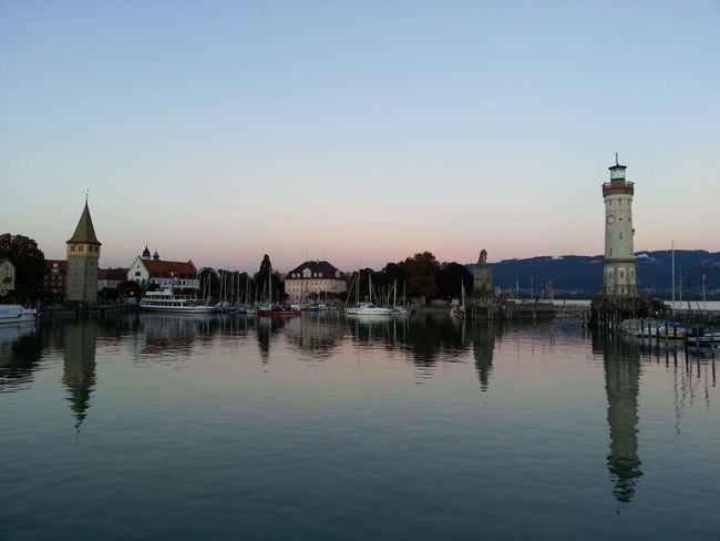 Beacon Coastline Landscape Evening Light Harbor Harbour View Lake Constance Lighthouse Lindau Bodensee Mirror Moored Boats Pier Architecture Bodensee Built Structure Calm Water Clear Sky Lake Lightreflections In Water No People Outdoors Reflection Sky Water Waterfront Waterreflections