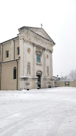 Snowy sacred. Snowing Church Churches Village Wintertime Snow Cold Temperature Winter Architecture Sky Building Exterior Built Structure