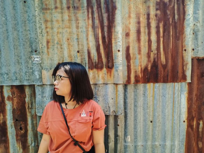 Young Women Standing Black Hair Fashion Sky Corrugated Iron Shutter Thinking No Parking Sign Thoughtful Window Box Asian  Closed Plain Background Pretty Caucasian Corrugated Sheet Metal Pensive Graffiti Protruding Street Art Building Attractive Glasses Sticking Out Tongue Head And Shoulders