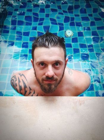 Blueyes man in the water Lookatme Relaxing Shotoftheday CarpeDiem  EyeEm Best Shots EyeEm Selects EyeEm EyeEm Nature Lover EyeEm Thailand Water Reflections Tattoo Man Beardlife Hairstyle Into The Wild Swimming Pool Only Men One Man Only Looking At Camera Water Headshot Beard Adult Blue Eyes Relaxation Lifestyles People Front View