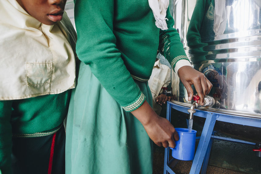 Africa African Boys Children Clean Water Close-up Cup Drinking Water Filter Girls Kids Metal Muslim Pouring Queuing Safe School Social Business Students Tap Thirsty  Uniform Water Water Filter Water Tank