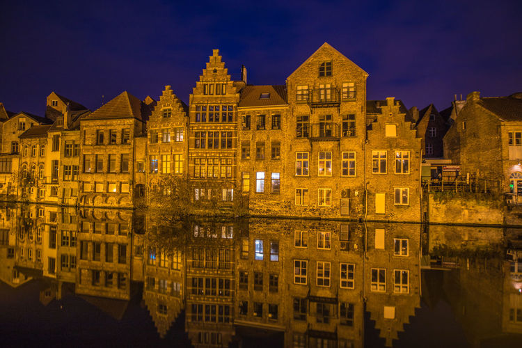 Reflection Of Building In Water At Night