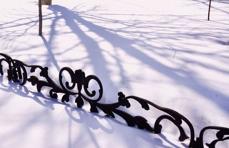 Close-up of snow on metal during winter