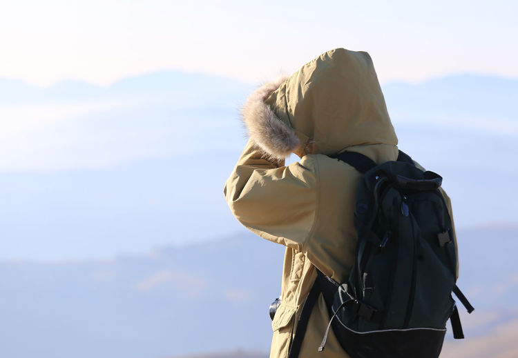 Person wearing jacket against sky