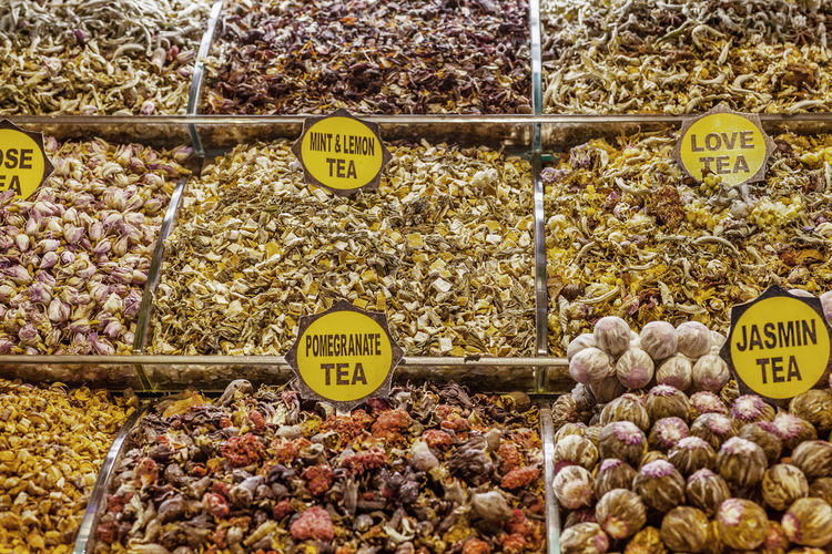Close-up of various herbal teas with tags at spice bazaar