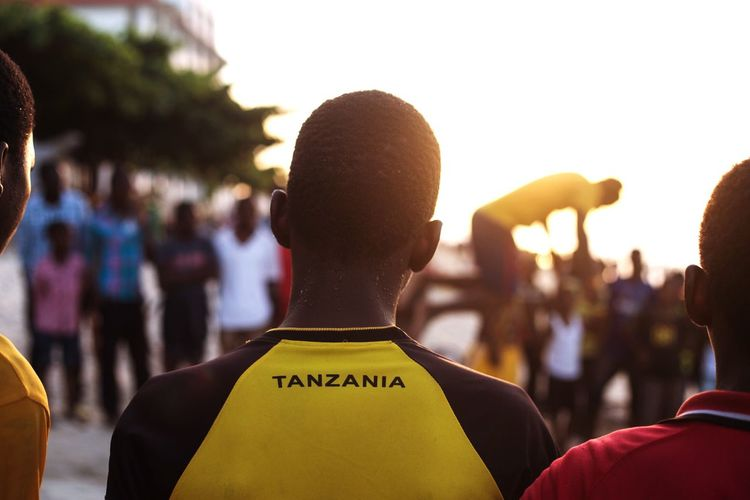 Community Zanzibar Community Group Of People Rear View Crowd Focus On Foreground Incidental People Event Large Group Of People Outdoors Sunset Lifestyles Real People