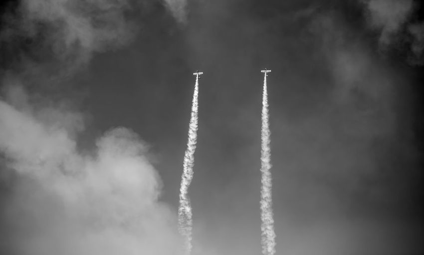 Cloud - Sky Sky Vapor Trail Low Angle View Smoke - Physical Structure No People Air Vehicle Day on the move Airplane Motion Transportation Mode Of Transportation Nature Outdoors Flying Travel Speed Mid-air White Color Aerospace Industry Pollution Plane Aerobatics Airshow Blackandwhite Black And White Black & White