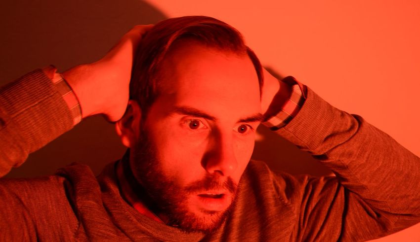 Bearded Man With Hands On Head I Cannot Believe This Look Of Disbelief Man In Shock Oh My God Strong Orange Light Headshot One Man Only Portrait Receding Hairline Serious Studio Shot