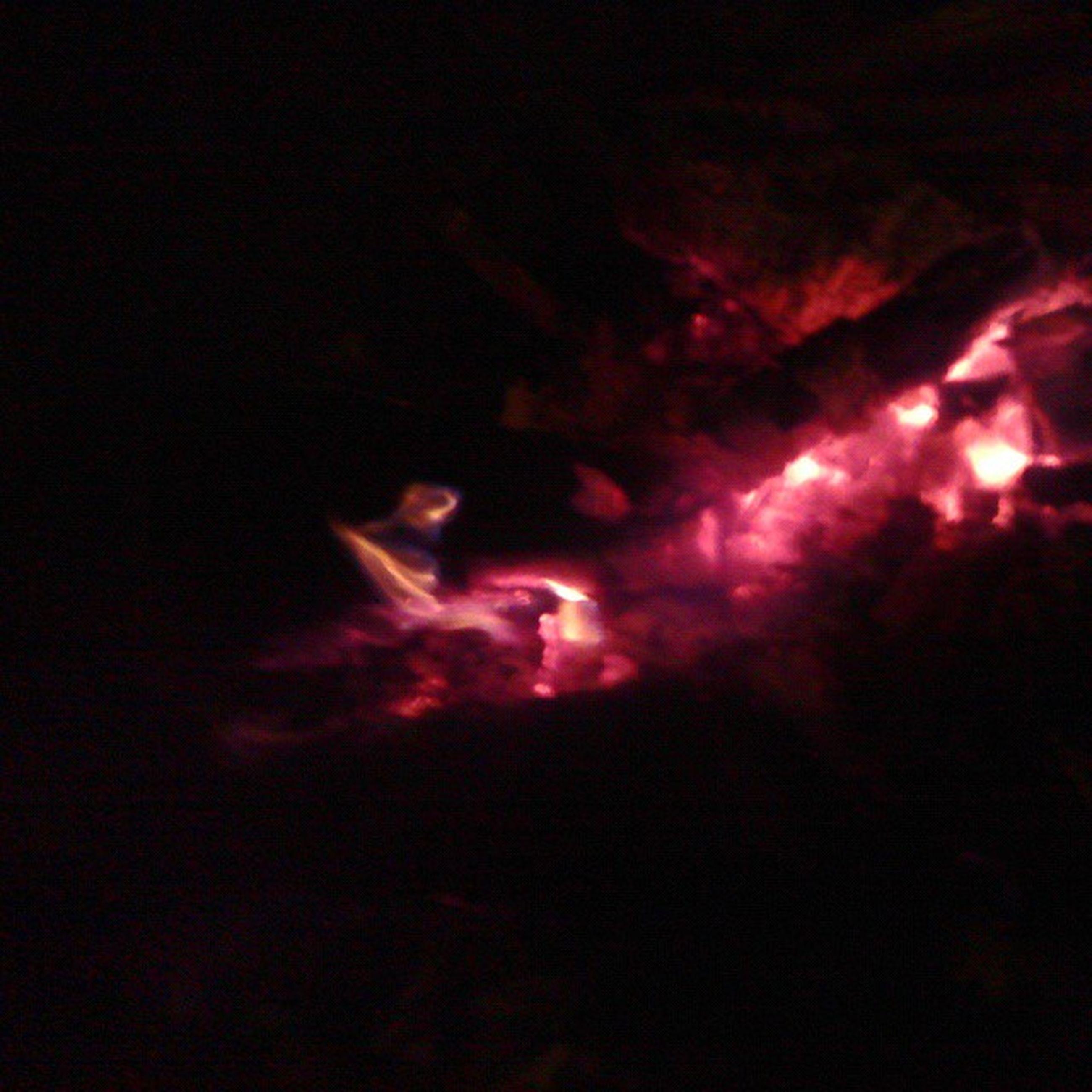 night, burning, flame, illuminated, dark, heat - temperature, fire - natural phenomenon, glowing, light - natural phenomenon, silhouette, danger, motion, performance, smoke - physical structure, skill, men, fire, orange color, indoors