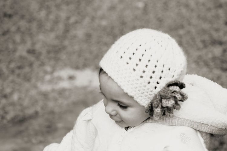 Close-up of cute girl wearing knit hat