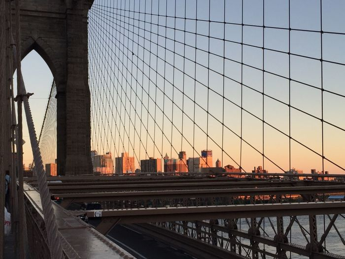 Brooklyn Bridge And Cityscape Against Sky During Sunset