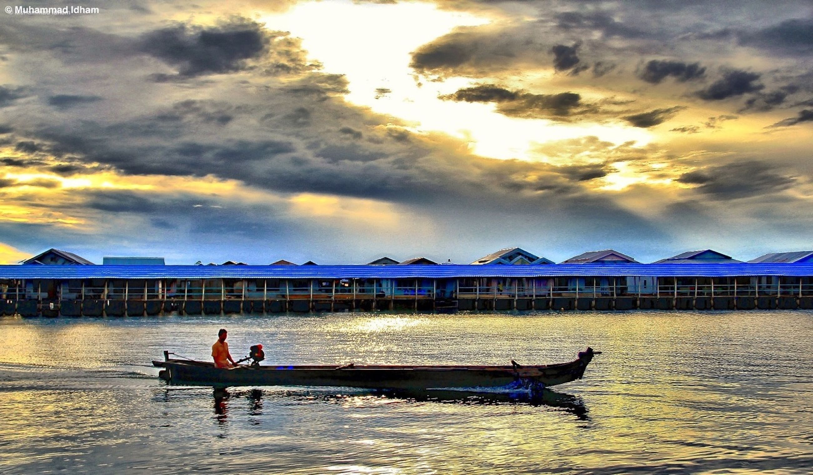 water, sky, sea, nautical vessel, cloud - sky, sunset, boat, transportation, lifestyles, leisure activity, scenics, mode of transport, men, beach, tranquility, vacations, tranquil scene, beauty in nature, cloud