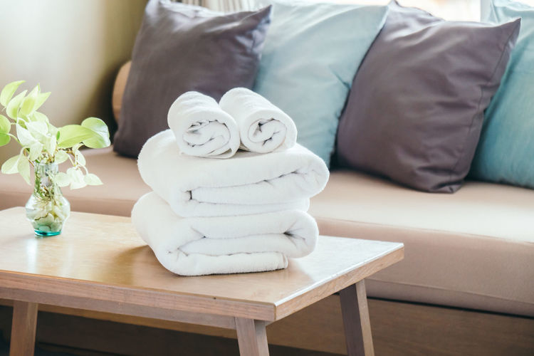 Stacked towels on table at home