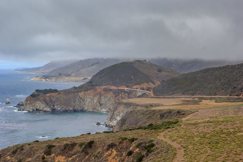 Landscape of rocky California coast with cloudy sky Beauty In Nature California Cloud - Sky Day Landscape Nature No People Outdoors Pacific Pacific Coast Highway Pacific Ocean PCH Scenics Sea Sky Tranquil Scene Tranquility Water